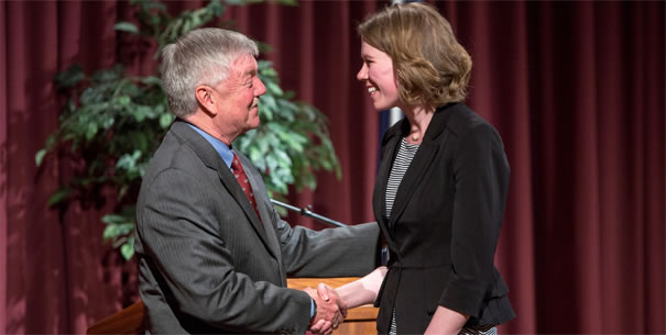 Scholarship recipient shaking Dean Gianchetta's hand