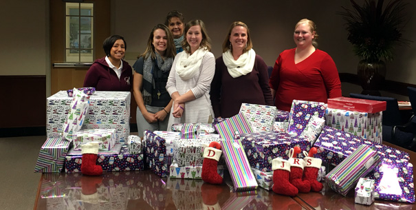 SoBA staff wrapping gifts for Adopt-a-Family/Veteran