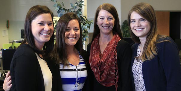 Missoulian photo of ATG employees, including alumni Kristin Mickey and Carey Davis