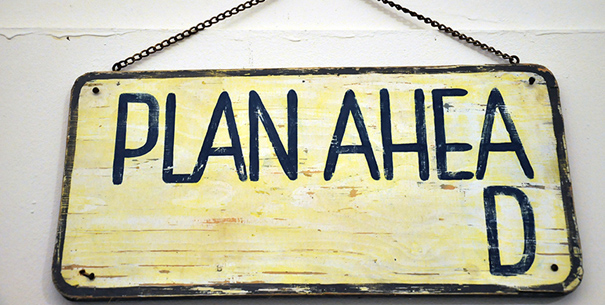 "Sign that reads ""Plan Ahea"" with the d on the second line"